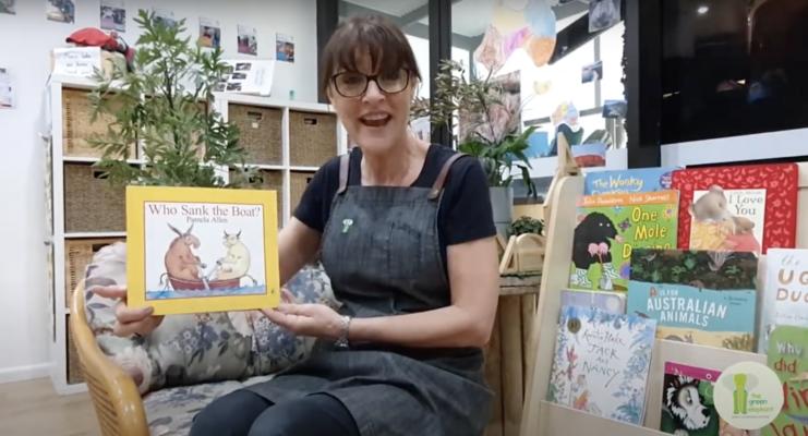Women Holding Children Book