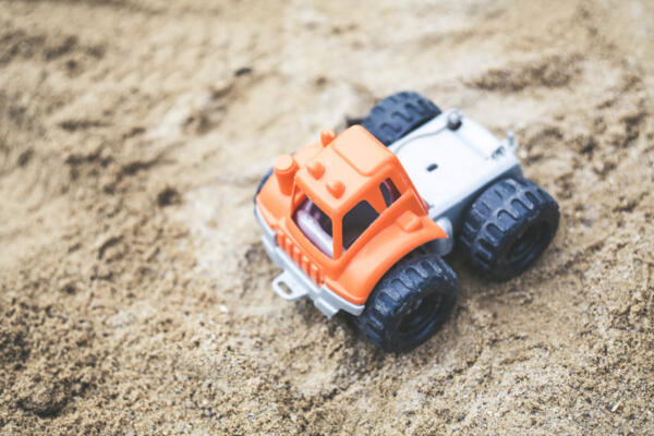 Toy truck In Sand 5 Long Term Benefits Of Early Centres