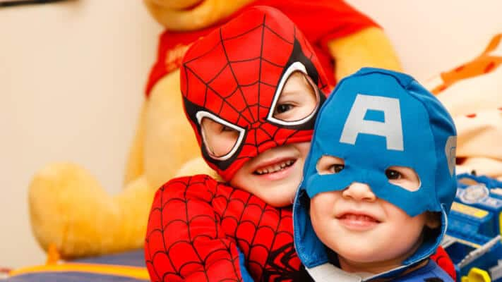 Children Dressed In Superhero Costumes